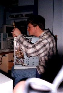 Andrew Baxter working on a computer